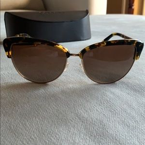 Oliver Peoples sunglasses.